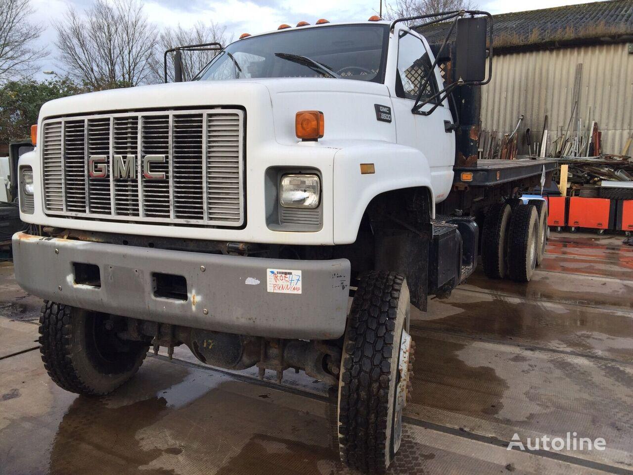 ciężarówka platforma GMC  3116 Engine Flatbed truck