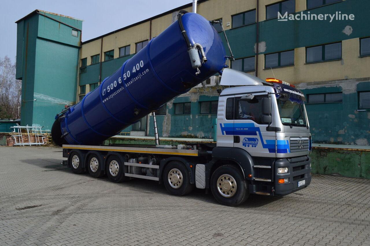 samochod do czyszczenia kanalizacji MAN TGA 41.430 10x4 32m3 kipper lenkachse